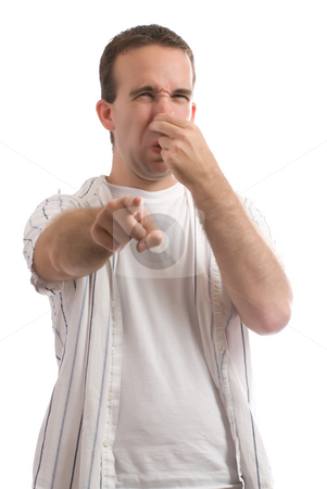 Stinky stock photo, A young man holding his nose because of a bad smell, isolated against a white background by Richard Nelson