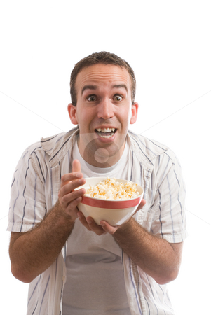 Popcorn stock photo, A young man holding a bowl of popcorn and watching a movie, isolated against a white background by Richard Nelson