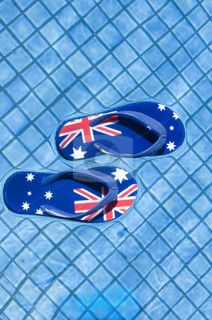 Australian Sandals stock photo, Pair of sandals printed with the Australian flag floating on a pool. by Lee Torrens