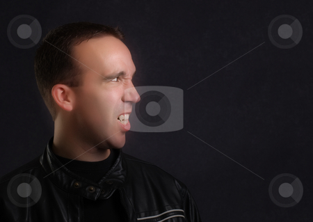 Vampire Portrait stock photo, Profile view of a modern vampire wearing a leather jacket by Richard Nelson