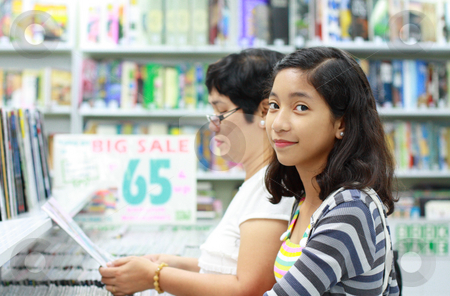 Student in the bookstore stock photo, Young asian student in the bookstore by Claro Alindogan