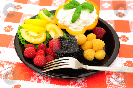 Fresh Berry And Cottage Cheese Salad stock photo, Lo-cal salad made with red and golden raspberries, blackberries, yellow heirloom tomatoes with an orange bell pepper filled with cottage cheese topped with fresh basil by Lynn Bendickson