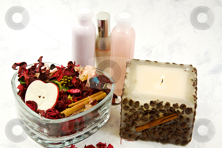 Spa detente  stock photo, Close up on a candle, lotions and potpourri - Spa Scene by Mehmet Dilsiz