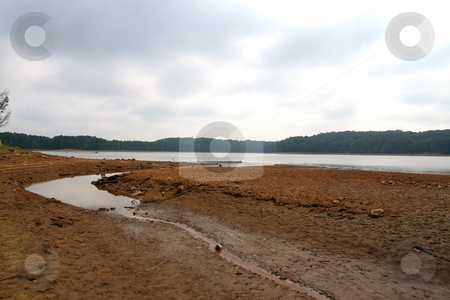 Dry lake stock photo, Drought conditions worsen as temperature rises above 100 degrees in Georgia by Jack Schiffer