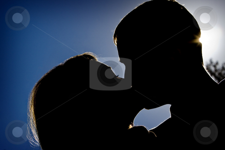 Summer's Kiss stock photo, Silhouette of a couple kissing by Ley Elliott