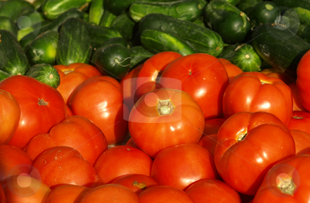 Fresh food stock photo, Fresh tomatoes and cucumbers for sale at the market by Tim Markley