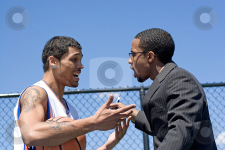 Angry Basketball Coach stock photo, A young basketball player getting yelled at by his coach. by Todd Arena
