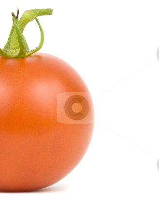 Tomato on white stock photo, Single ripe tomato on a white background by John Teeter