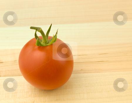 Single Tomato stock photo, Single Ripe Tomato on a wooden background by John Teeter