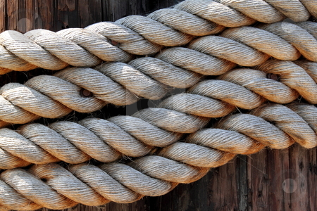 Rope stock photo, Old rope to tied a sail boat to the pier by Henrik Lehnerer