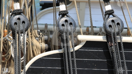 Rigging stock photo, Close up of block and rigging on a sail boat by Henrik Lehnerer
