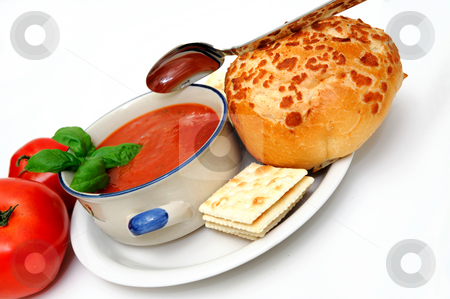Tomato Soup And Basil stock photo, Bowl of tomato soup with crackers and a roll with  fresh tomatoes isolated on a white background by Lynn Bendickson
