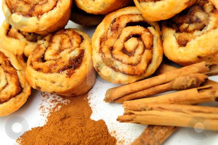 Cinnamon And Rolls stock photo, Powdered and stick cinnamon with fresh baked mini cinnamon rolls by Lynn Bendickson