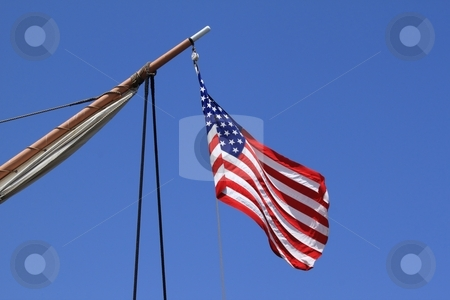 USA flag sail ship stock photo, USA flag on an old sail ship with blue sky as background by Henrik Lehnerer