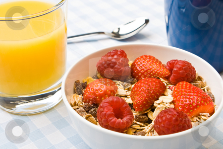 Delicious muesli with fruit stock photo, Muesli with fresh raspberries and strawberries by Robert Anthony