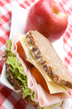 Fresh wholemeal cheese and ham sandwich stock photo, Fresh wholemeal cheese and ham sandwich with a red apple by Robert Anthony
