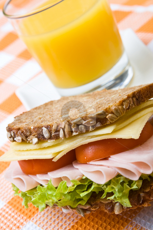 Fresh wholemeal cheese and ham sandwich stock photo, Fresh wholemeal cheese and ham sandwich with orange juice by Robert Anthony