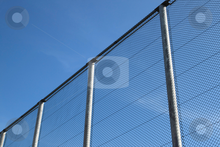 Big wire chain security fence. stock photo, Big wire chain security fence. by Stephen Rees