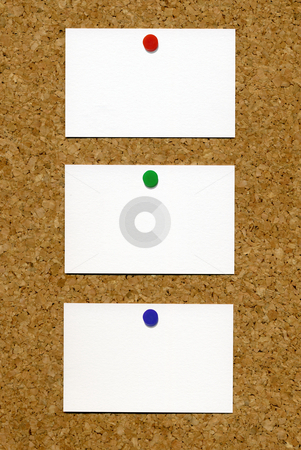Three blank white business cards attached to a cork notice board. stock photo, Three blank white business cards attached to a cork notice board. by Stephen Rees
