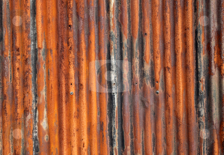 Rusty old corrugated iron fence close up. stock photo, Rusty old corrugated iron fence close up. by Stephen Rees