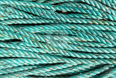 Coiled rope from a fishing boat close up. stock photo, Coiled rope from a fishing boat close up. by Stephen Rees