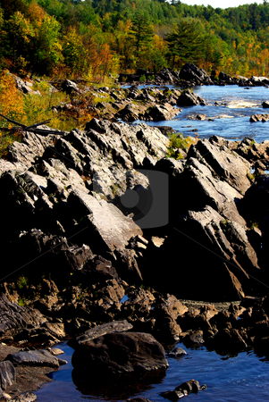 Rocky Fall Landscape stock photo, The rocky river rapids of Minnesota's  St. Louis River reflects a brilliant blue sky on a fall morning.  The St. Louis River with its slate rock river bed is a prominent feature of Jay Cooke State Park.  The rock strewn river is the primary tributory emptying into Lake Superior. by Dennis Thomsen