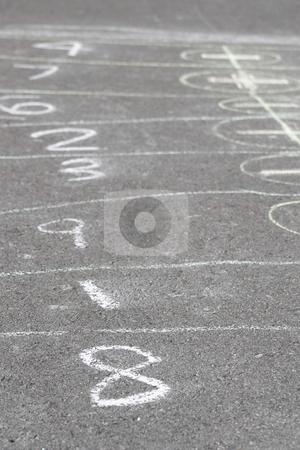 8 on hopscotch stock photo, Game of hopscotch drawn with chalk on asphalt by Yann Poirier