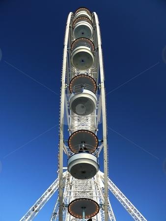 Ferris Wheel - sideview  stock photo, Ferris Wheel with blue sky background - sideview by Milos Pavlovsky