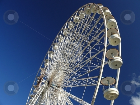 Ferris Wheel stock photo, Ferris Wheel with blue sky and cloud on background by Milos Pavlovsky