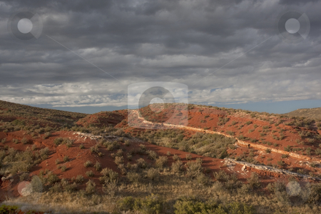 Desert hilly landscape under stormy sky stock photo, Red Mountain Open Space semi desert landscape in northern Colorado near Wyoming border, boundary between mountains and plains, late summer by Marek Uliasz
