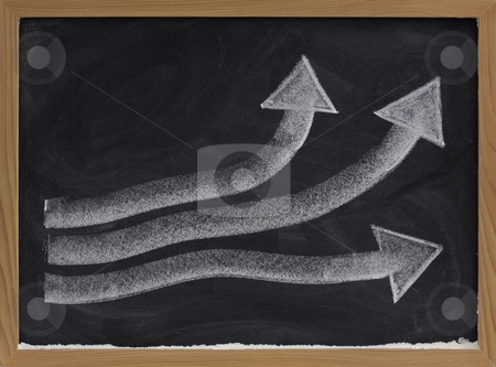 Growth or progress concept on blackboard stock photo, Growth, progress or success concept presented with thick white chalk arrows on blackboard, eraser smudges by Marek Uliasz