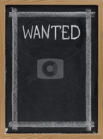 Wanted - blank blackboard sign stock photo, Wanted sign handwritten with white chalk on blackboard with copy space below by Marek Uliasz