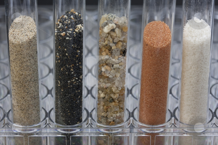 Sand samples in laboratory testing tubes stock photo, Five glass testing tubes with different sand samples collected from beaches and deserts of western USA and Hawaii by Marek Uliasz