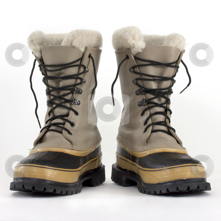 Heavy snow boots stock photo, A pair of heavy snow boots on white background, low angle perspective by Marek Uliasz