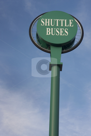 Shuttle buses sign against blue sky stock photo, Bus stop sign with bike wheel at the campus of Colorado State University, Fort Collins by Marek Uliasz