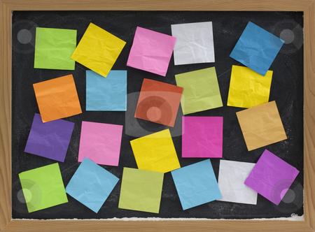 Colorful blank notes on blackboard stock photo, Blackboard covered with colorful blank sticky notes by Marek Uliasz