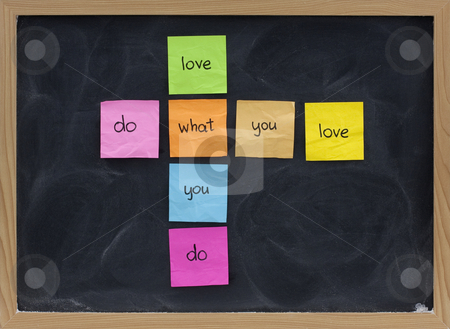 Do what you love concept on blackboard stock photo, Do what you love, love what you do - happy life and work concept presented on blackboard with colorful sticky notes, white chalk smudges by Marek Uliasz