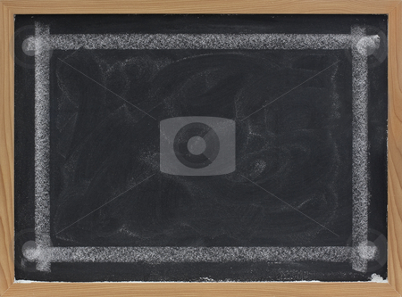 Blank blackboard with eraser smudges stock photo, Blank blackboard with eraser smudges and thick white chalk line frame by Marek Uliasz