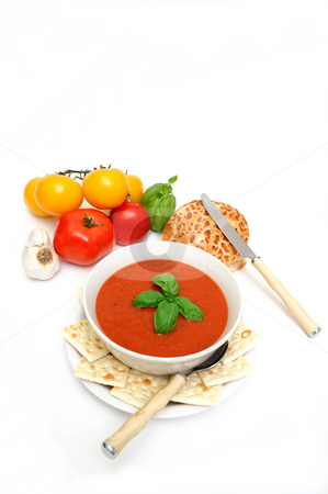 Tomato soup stock photo, Bowl of tomato soup with crackers and a roll with  fresh tomatoes isolated on a white background by Lynn Bendickson