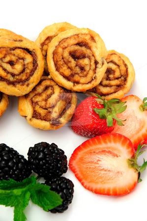 Cinnamon Rolls And Berries stock photo, Fresh baked mini cinnamon rolls with strawberries and blackberries by Lynn Bendickson