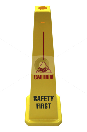 Safety sign isolated stock photo, A plastic yellow self-standing safety sign featuring the words 'Caution, Safety First', isolated on white by Lee Torrens