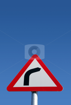 British road bend to right sign and a big blue sky. stock photo, British road bend to right warning sign and a big blue sky. by Stephen Rees