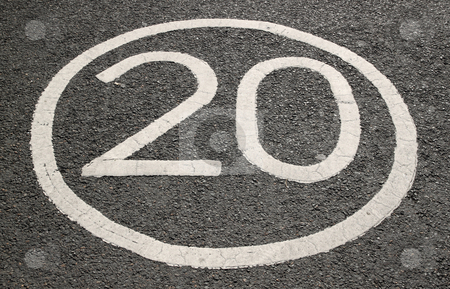 20 miles per hour sign on a tarmac road. stock photo, 20 miles per hour sign on a tarmac road. by Stephen Rees