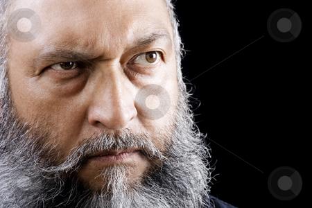 Menacing Man stock photo, Stock image of menacing man with long beard over dark background by iodrakon