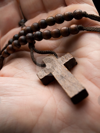 Religious moment stock photo, Rosary in the hand with focus on the cross, shallow DOF by Vladimir Koletic