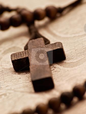 Rosary cross stock photo, Closeup of rosary cross,shallow DOF, light sepia toned by Vladimir Koletic