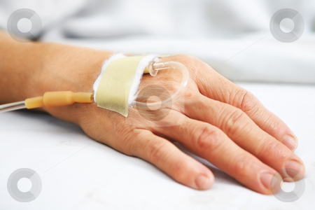 Old woman hand with IV stock photo, Old woman hand with IV in hospital's bed by Rudyanto Wijaya