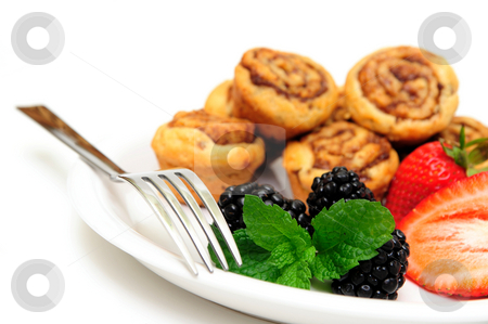 Cinnamon Rolls and Berries stock photo, Cinnamon Roll pastries with fresh picked blackberries and Strawberries with a mint leaf garnish by Lynn Bendickson