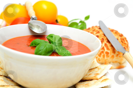Tomato Soup With Basil stock photo, Bowl of tomato soup with crackers and a roll with  fresh tomatoes isolated on a white background by Lynn Bendickson