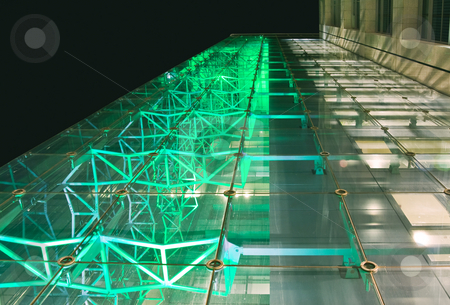 Facade of office building at night stock photo, A facade of office building shot at wide angle. hi-tech style metal construction is seen through the glass, illuminated with green light by Elizaveta Geshiktor
